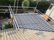 Part Roof Replacement - Replaced the old concrete roof tiles with new Monier tiles to help stop leaks in this area. Carried out by Accredited Roof Coatings