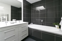 High contrast, stylistic bathroom designed by Add Value