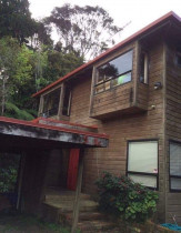 Titirangi - This house we did  reclad before it got uplifted and moved.