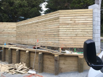 Retaining wall/fence - retaining wall and privacy fence built to screen driveway off