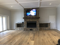 Lounge area- new build cottage in puhoi - Lovely Riverstone fire place with a Crawford ceiling, French oak flooring