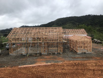 Timber framing - Frames and roof up on cottage in puhoi