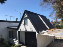 Billy Boy in Action, painted roof in Blockhouse Bay, Auckland - Working hard to get this roof shining bright before summer.