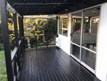 Billy Boy in Action, deck painting in North Shore, Auckland - This area came up so nicely after a lot of hard work and dedication from the Billy Boy in Action team. I worked with the owners to help create a nice spot to enjoy the afternoon sun.