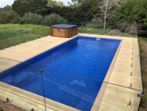 Pool deck with glass rail