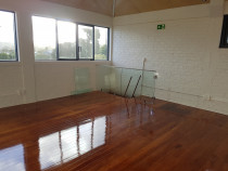 Onehunga building - New joinery, painted bricks, finished floors and glass balustrade