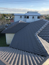 Concrete tile roof after restoration - Restoration consisted of full roof wash and mold treatment, replacement of cracked tiles, Ridge and hip repoint and 4 coat reseal system.