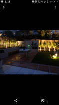 Patio and water feature lit up with up lights