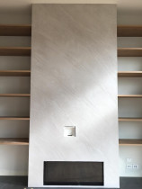 Fire place feature wall - another example of a concrete look using a 'split stone' texture