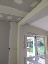 Plastering beam - Plastered beam, ceilings and walls to smooth clean finish .