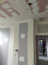 Plastering - Plastering ceilings , walls , two external corners and square stop .