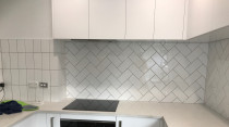 Herringbone 200 x 100 combination completed by Just Splashbacks - Female Tiler