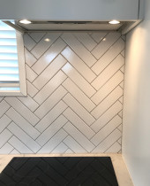 75 x 250 herringbone by Just Splashbacks - Female Tiler