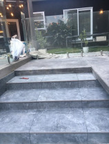 Stone tiling - swimming pool steps