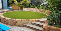 Brickwork, deck and planting by Lakeside Landscapes
