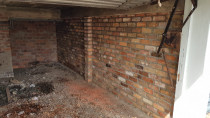 Reclaimed Brick Garage wall by Lakeside Landscapes