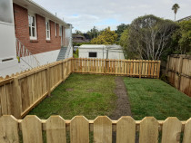 1.2 meter boundary fence with gate , lawn extension. - Law landscapes completed  this 20m2 retained lawn extension with a 1.2 meter boundary fence.