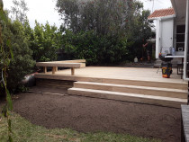 35m2 pine deck - Law Landscapes completed this 35m2 pine deck with a seat boundary round the perimeter. There was a old damaged deck here before. The new deck was built from 140x32 pine decking with H4 timber for internal foundation.