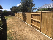 New Fence Build by Long Building Solutions - New neighbour friendly fencing complete with a concrete mowing strip.