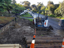 Green Bay bobcat e 20 mini excavator - bobcat e20 mini excavator drilling holes for a new timber retaining wall in green bay auckland