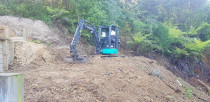 North Shore ihi 3.5 ton - ihi digger at work regrading a steep slope on the north shore in auckland