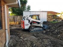 Henderson skid steer - this is a 3 ton t590 skid steer excavation a rear courtyard for a new patio and retaining wall in henderson auckland