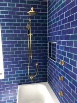 Bright bathroom in Mt Albert by North Shore Plumbing - Nice tiles with brass tapeware.