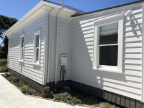 Villa repaint by Paint Crew - Recent villa repaint in Muriwai, Auckland by Paint Crew