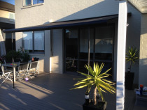 Retractable motorised awning - Motorised retractable awning with full cassette