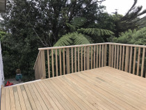 Looking down the stairs and to the corner details. - This deck was over 1m off the ground but under 1.5m so it requires a code compliant balustrade but does not require council consent.