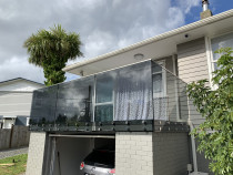 Double disc system glass balustrade Euro grey Mt Roskill by Royal Glass Ltd