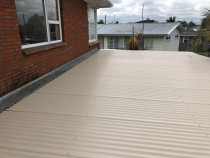 Mangere clearlite reroof after Rs Roofing Ltd - Re roofed with Corrugate desert sand colour