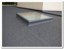 SKYLIGHT INSTALL ONTO FLAT ROOF - Although our skylights can be installed to a 0° pitch, we do pitch them to 4° to prevent water ponding and staining the glass.