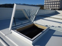 GLAZED ROOF ACCESS HATCH WITH GAS STRUTS - These are custom made to your size/shape/colour requirements.  For easy safe access onto your roof.  This can save costs for scaffold for the simplest of jobs like roof or heat pump maintenance, installation of heat pumps and the like.