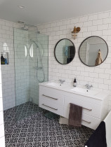 Devonport Bathroom Renovation by Sure Bathrooms - Sure Bathrooms remodelled this spacious Villa bathroom using tasteful, artisan flooring with smart, white wall tiles to increase light, creating a cosy, refreshing retreat for the whole family