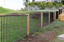 Aluminium security fence with wooden posts