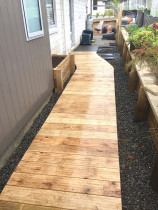 Boardwalk footpath over ornamental riverstone