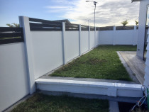 Solid panel fence with horizontal aluminium rails on top