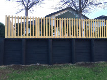 Open Picket Fence on top using dressed timber on top of a retaining wall.