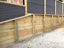 Retaining walls using tongue and groove timber with horizontal colour steel fences