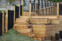 Aluminium security fencing with wooden posts. Funky steps, raised garden and decking