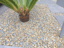 Paving stones, ornamental riverstone add garden layout