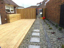 New Deck, Storage box, Upright dressed fence, Paving stone walkway and ornamental riverstone
