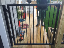 Aluminium security gate over deck with new lawns and raised gardens