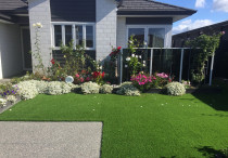 Artificial  lawn and small raised garden.