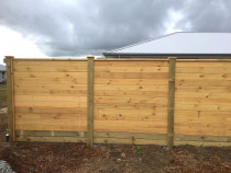 Horizontal fence using tongue and groove timber for solid timber finish