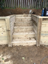 Wooden steps inset into retaining wall