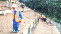 Creating several levels of retaining walls on a steep bank to plant out the bank in gardens