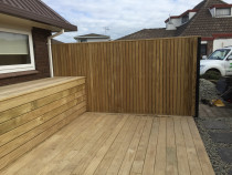 Deck with storage box and vertical fence using dressed 68 x 19 timber. Stainless screws