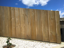 Vertical 200mm wide paling fence with batten covering gap